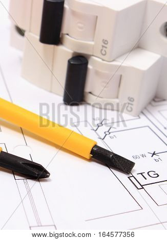 Screwdriver And Electric Fuse On Construction Drawing Of House
