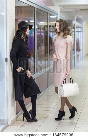 Cute young women shopping at store sale