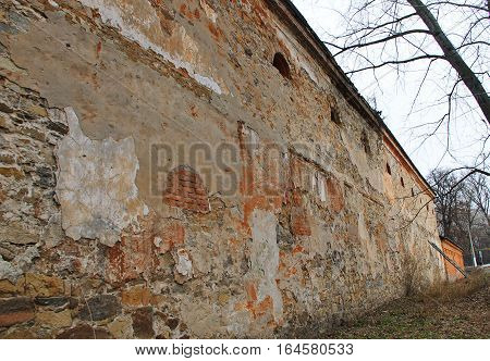 The stone wall of the ancient building