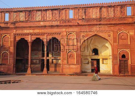Agra, India - November 7: Unidentified Man Sweeps Courtyard Of Jahangiri Mahal In Agra Fort On Novem