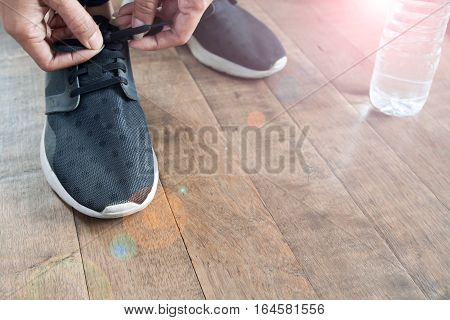 Closeup of woman tying shoelaces Working out concept with copy space