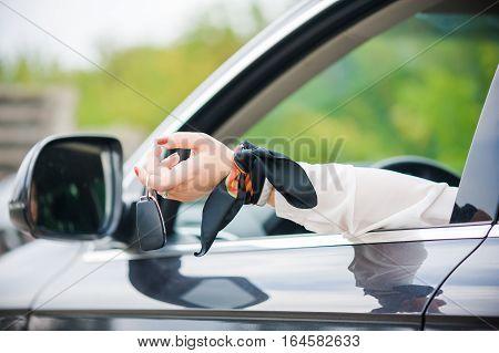 Car Keys. Seller woman hand giving keys