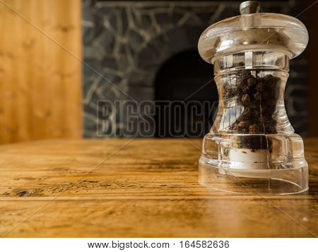 Pepper in glass on the wooden table