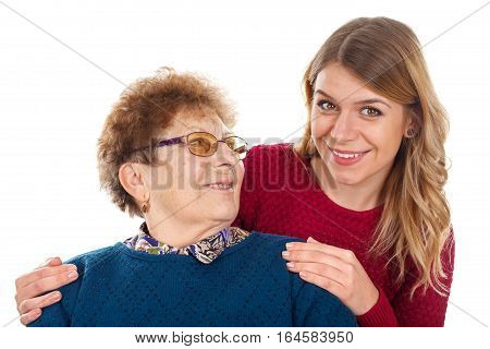 Portrait of a smiling young woman with her grandmother