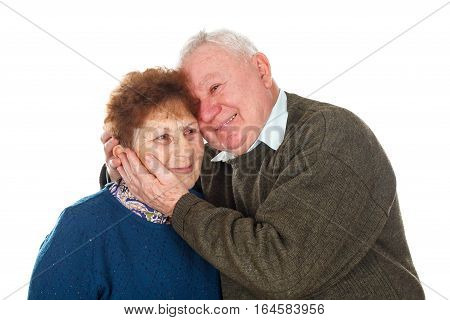 Picture of an old couple hugging each other - isolated background