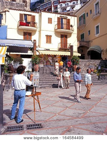 POSITANO, ITALY - SEPTEMBER 22, 1996 - Artist painting on the beach promenade Positano Amalfi Coast Italy Europe, September 22, 1996.