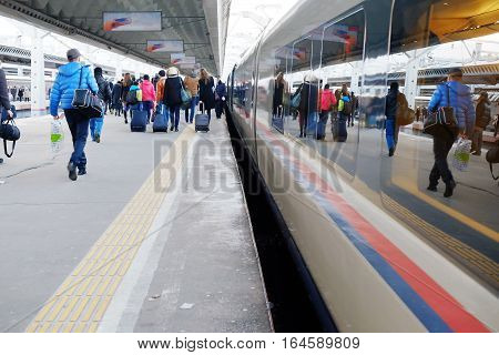 high-speed train is at the platform of St.-Petersburg