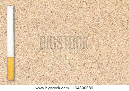 Cigarette tobacco on cork board background for design with copy space for text or image.