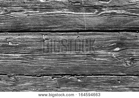 Black And White Weathered Log House Surface.