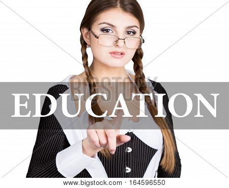 education written on virtual screen. sexy secretary in a business suit with glasses, presses button on virtual screens. technology, internet and networking concept