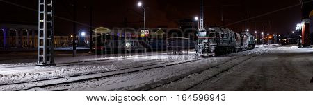 RUSSIA, ORYOL - 09 JAN 2017: Panoramic winter view on railway station with locomotive