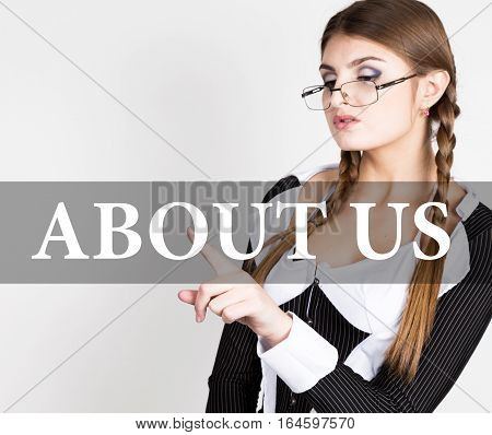 about us written on virtual screen. sexy secretary in a business suit with glasses, presses button on virtual screens. technology, internet and networking concept