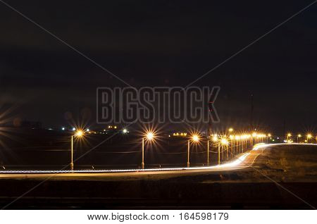 Night-time lighting of the highway with light strips from automobile headlights