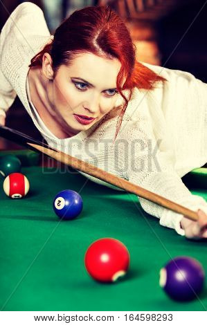 Young Attractive Woman Plays The Game Of Snooker Pool Table. Fun And Competition Concept
