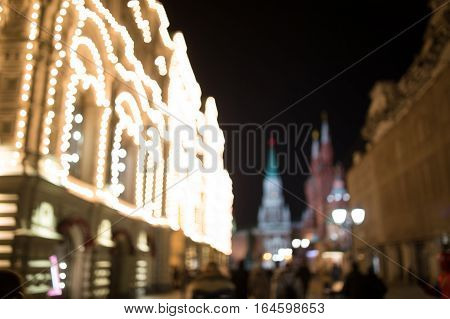 Defocused photo of building with garlands at night