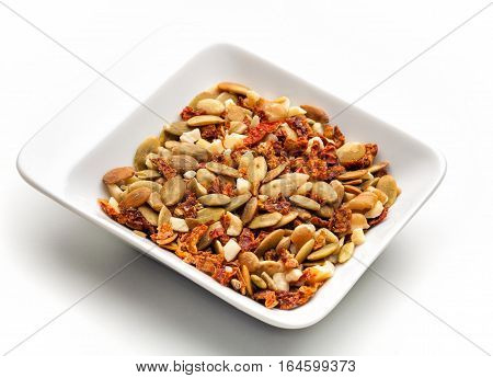 Mixed dried shelled fruit and dried tomatoes. Salad Dressing. white background. Photo made with macro lens.