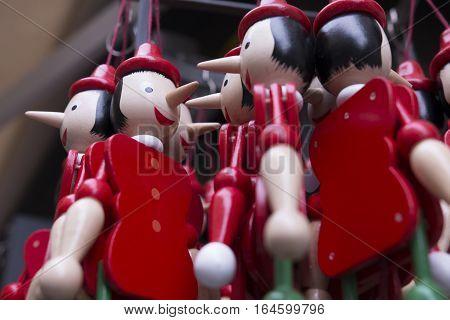 Wooden pinocchio puppet as a souvenir of Italy.