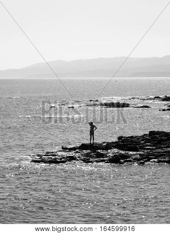 Rocks on the coast of Cretan Sea near Hersonissos Crete Greece. Black and white