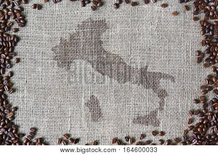 Burlap texture with coffee beans border. Sack cloth background with Italy map on it in the middle. Brown natural sackcloth canvas. Seeds at hessian textile