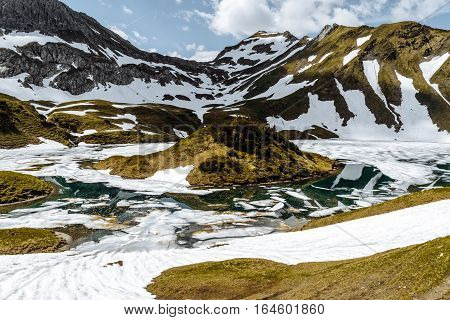 Schrecksee mountain lake in spring, still a lot of snow