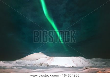 Northern lights Aurora borealis above Mountains Landscape Winter Travel scandinavian night scenery natural colors