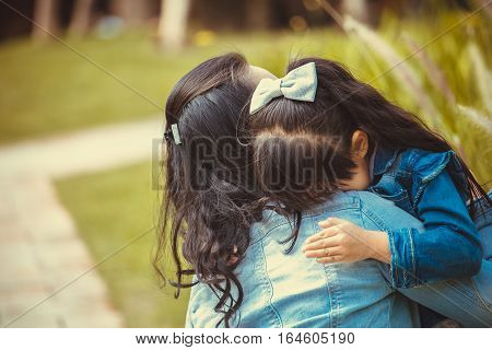 Familylove and happy people concept Mother comforting her crying little girl - parenthood concept