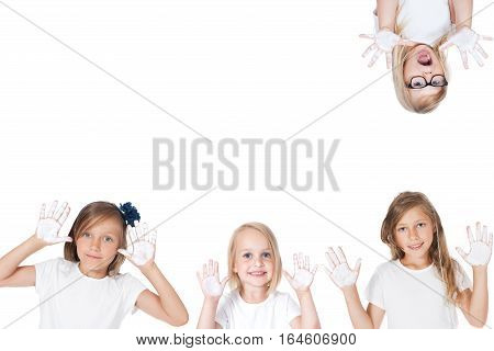smiling child with painted hands - studio