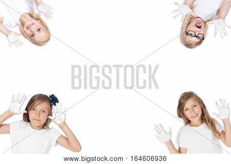 smiling child with painted hands in studio