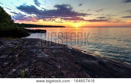 Scenic Sunset Over The Inland Sea. Sunset over the horizon of Lake Superior on the Pt. Abbaye  Peninsula. The point is a nature preserve maintained by the Michigan Nature Association. L'Anse, Michigan