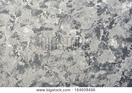 Gray plaster wall grunge structure. Scratched concrete background.