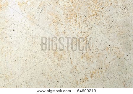 mottled decorative stucco with stone structure background