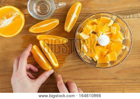 Make orange juice at home. Sliced oranges for fresh orange juice.