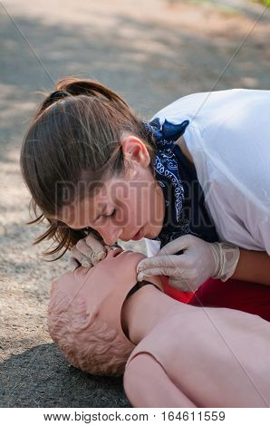 first aid treatment procedure on cpr dummy