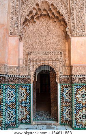 Marrakesh Morocco - December 8 2016: Interior courtyard of the five century old school or Ali ben Youssef Medersa in the center of Marrakesh Morocco.