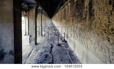 Siem Reap, Cambodia, December 06, 2015: A corridor with columns inside the Angkor Wat. Angkor Wat is one of the famous tourist attraction in the world, located at Cambodia.