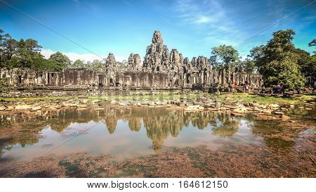 Siem Reap, Cambodia, December 06, 2015: The many face temple of Bayon at the Angkor Wat site in Cambodia