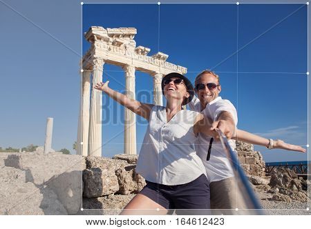 Cropping for social networks post photo of young couple on antique ruins. Temple of Apollo Side Turkey