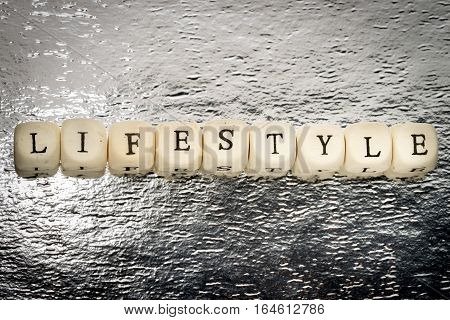 Lifestyle Word On A Wooden Cubes On A Shiny Silver Background