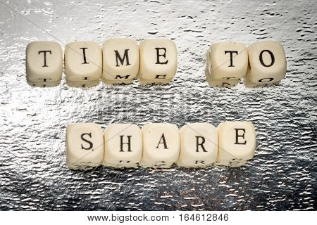 Time To Share Text On A Wooden Cubes On A Shiny Silver Background