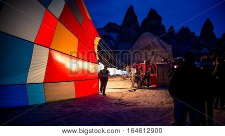 Cappadocia, Turkey - November 15, 2014:  Morning of the Hot Air Balloon being hot air filled with flames