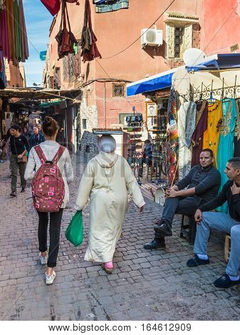 Marrakesh Morocco - December 8 2016: People and shops in the famous souks of Marrakesh Morocco Africa.