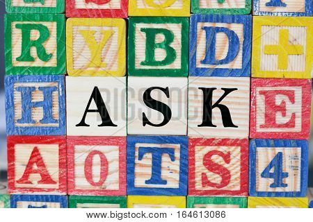 Ask a question to find answers with wooden letter cubes