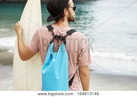 People, Sports And Hobby. Young Caucasian Man Wearing Snapback And Stylish Sunglasses Standing On Se
