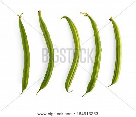 Row of ripe fresh green french beans isolated on white background. Closeup image of ideal vegetables, healthy natural organic food