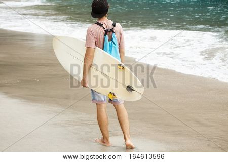 Stylish Young Man Standing Barefooted On Beach On Ocean Shore And Looking Into Distance, Ready To Hi