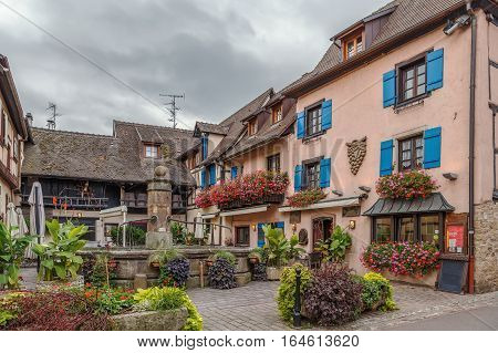 Courtyard with historical houses in Eguisheim Alsace France