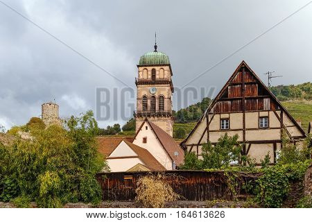 View of Kaysersberg with church tower and ruins of castle Alsace France