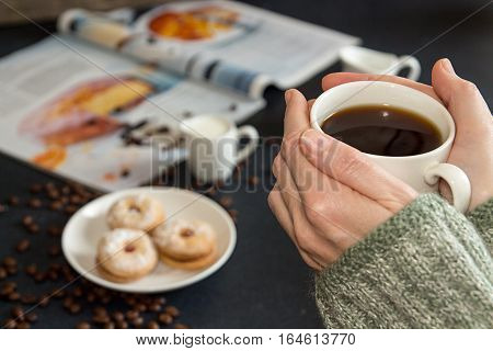 Cup Of Coffee In Woman Hands. Saucer With Cookies, Roasted Coffee Beans