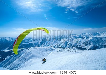 Winter in Greater Caucasus Mountains. Georgia (country). Gudauri ski resort. Paragliding