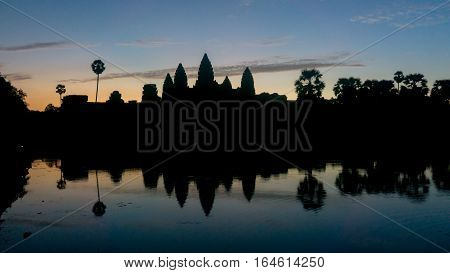 Siem Reap, Cambodia, December 06, 2015: Silhouette of Angkor Wat temple in Cambodia during sunrise. Angkor Wat is one of the famous tourist attraction in the world, located at Cambodia.